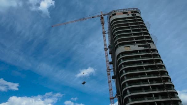 building of a high-rise house under sky, work of construction crane, real estate market, copy space