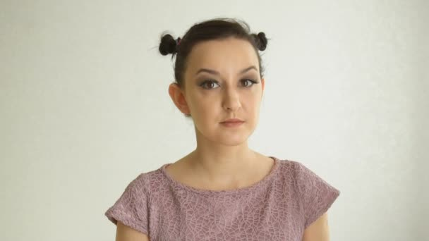 Portrait of a girl with long false eyelashes and brown eyes. Cute female model with vogue makeup on white background