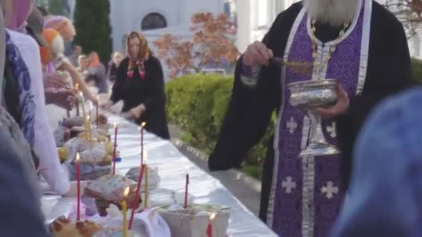 Church holiday Easter, consecration of Easter cakes and eggs in the church, tradition, religion BOBRUISK, BELARUS - April 27, 2019