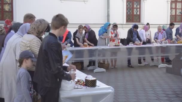 Church holiday Easter, consecration of Easter cakes and eggs in the church, tradition, culture BOBRUISK, BELARUS - April 27, 2019