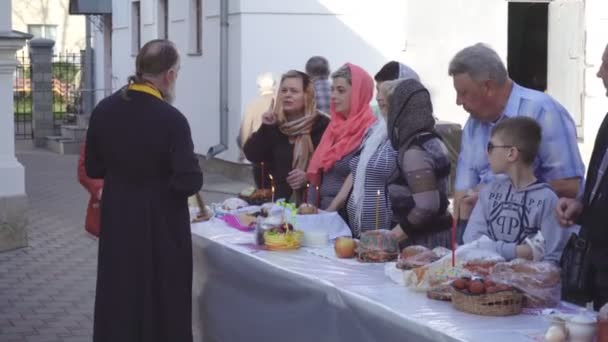 Church holiday Easter, consecration of Easter cakes and eggs in the church, tradition in BOBRUISK, BELARUS - April 27, 2019