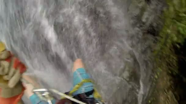 Man Getting Wet While Rappelling Down the Big Cold High Waterfalls Costa Rica