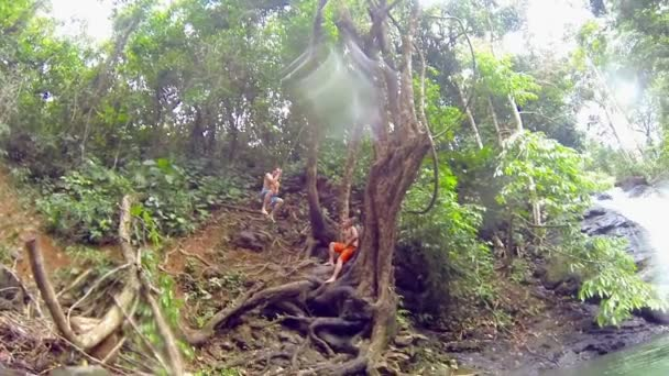 Recreational Adventure Swing from a Tree and Dive in a River in Costa Rica