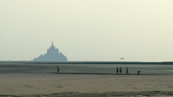 Zoom-out of Teens Playing Football on the Sandy Beach of Normandy