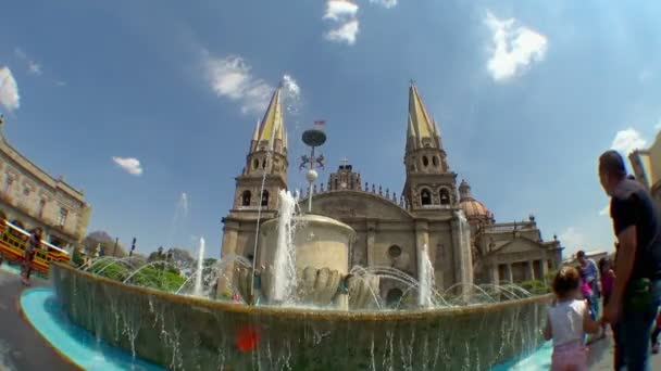 Wide View: Fountain in Front of the Cathedral of the Assumption of Our Lady in Guadalajara Mexico With Families Playing with the Water