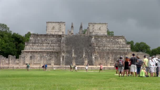 People standing and looking at the ruin of the Plaza of a Thousand Columns in Mexico