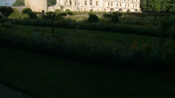 Pan Upward: Amazing and Grand Chateau de Chenonceau of France on a Bright Clear Day with Kids Playing in the Courtyard