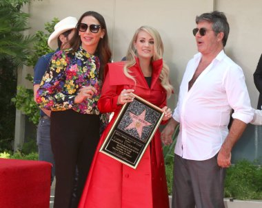 LOS ANGELES - SEP 20:  Lauren Silverman, Carrie Underwood, Simon Cowell at the Carrie Underwood Star Ceremony on the Hollywood Walk of Fame on September 20, 2018 in Los Angeles, CA
