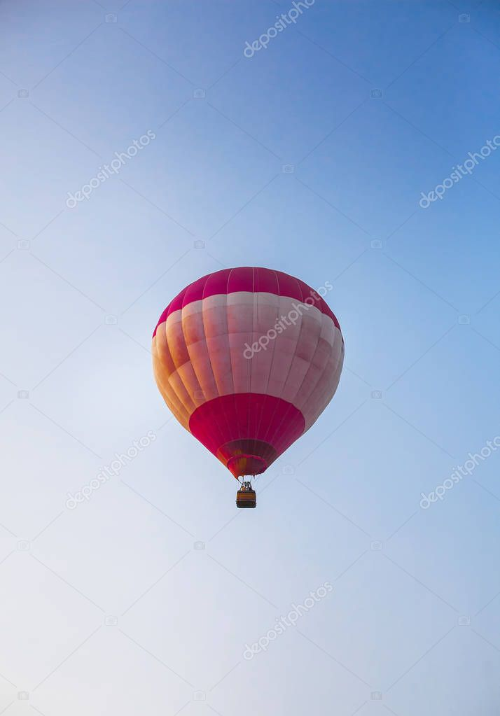 hot air balloon in flight on blue sky