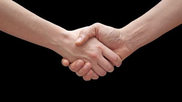 Dvě osoby potřesení rukou na černém pozadí, partnerství důvěra, respektovat znamení