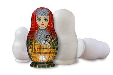Matryoshka. Painted and unpainted. Isolated on white