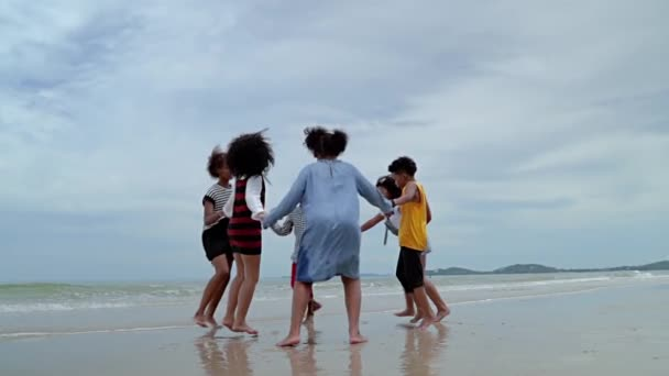 slow motion video shot of  African-American children are dancing and dancing on the beach, in the summer atmosphere.