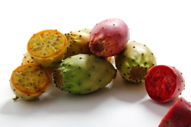 raw prickly pears white background