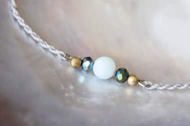 Natural mineral Amazonite stone bead bracelet on pearl background