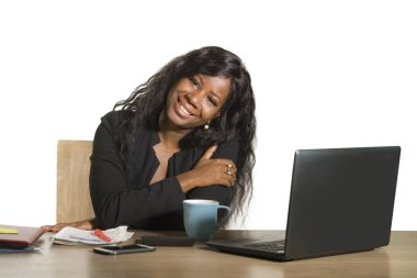 young happy and attractive black afro American business woman working at office computer desk smiling successful posing corporate as efficient and experienced CEO of financial company