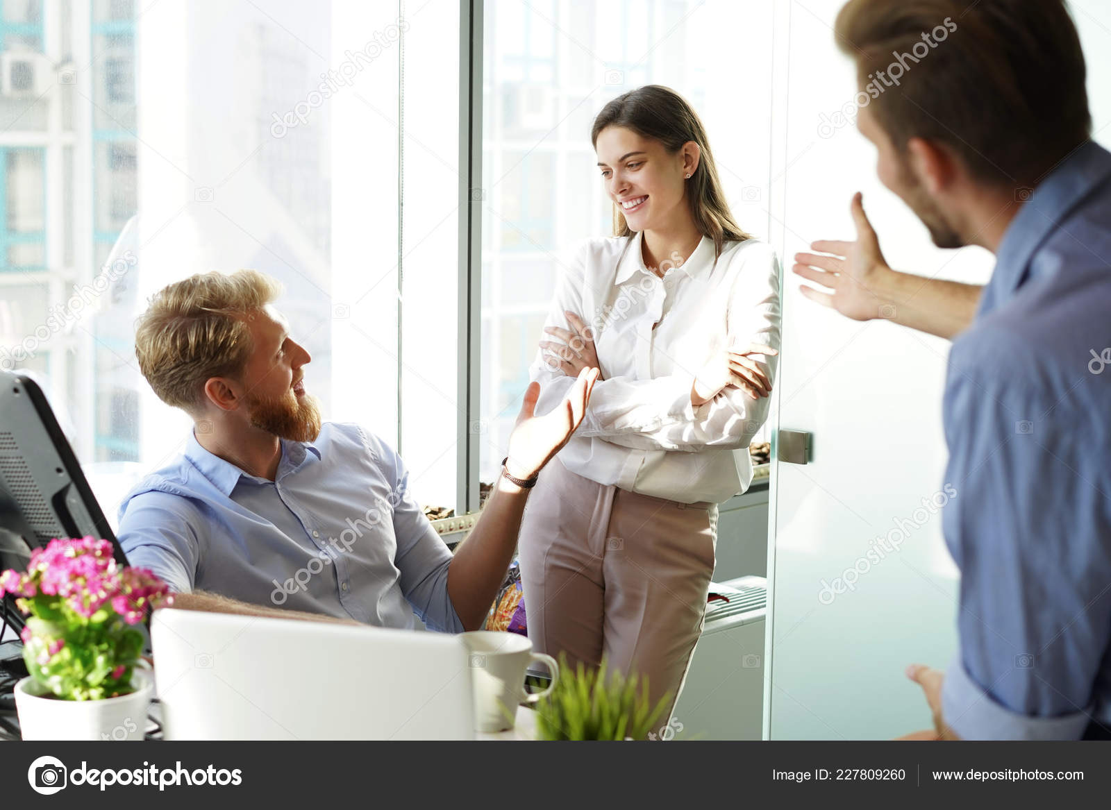 fe452394f85 Young Colleagues Smart Casual Wear Working While Spending Time Office —  Stock Photo