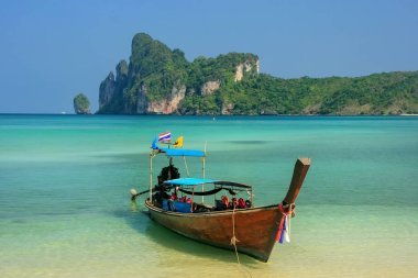 Longtail boat anchored at Ao Loh Dalum beach on Phi Phi Don Island, Krabi Province, Thailand. Koh Phi Phi Don is part of a marine national park.