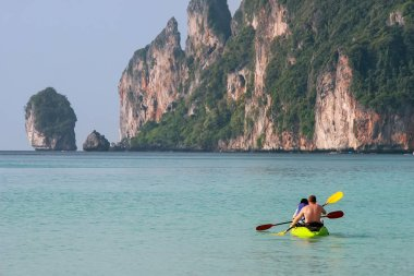 People kayaking at Ao Loh Dalum on Phi Phi Don Island, Krabi Province, Thailand. Koh Phi Phi Don is part of a marine national park.