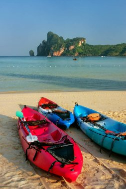 Colorful kayaks at Ao Loh Dalum beach on Phi Phi Don Island, Krabi Province, Thailand. Koh Phi Phi Don is part of a marine national park.