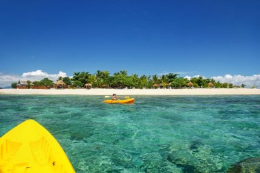 Kayaking near South Sea Island, Mamanuca islands group, Fiji. This group consists of about 20 islands.