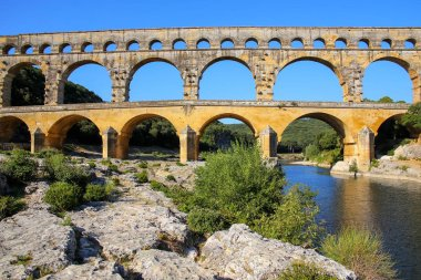 Aqueduct Pont du Gard and Gardon River in southern France. It is the highest of all elevated Roman aqueducts.
