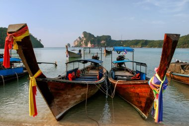 Longtail boats anchored at Ao Loh Dalum beach on Phi Phi Don Island, Krabi Province, Thailand. Koh Phi Phi Don is part of a marine national park.