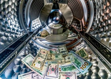 Money laundering symbol, banknotes in washing machine with the door open