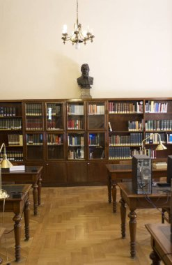 interior of a library with a wooden table