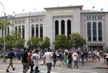 Yankee fans head to the stadium to enjoy the game