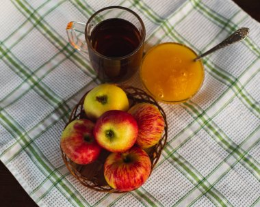 Cup of Tea, Apple, Honey. Tasty and Healthy breakfast on a White Tablecloth. Countryside concept