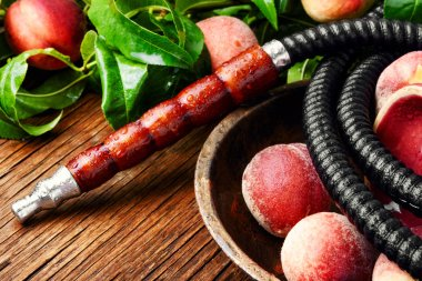 Hookah for smoking with the aroma peach.Peach shisha