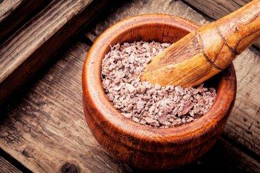 Grinded rhizomes of plant iris in mortar.Herbal medicine.Herbalism