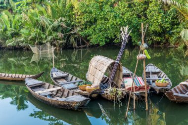 Traditional wooden boats in a small river in the Mekong Delta region of southern Vietnam