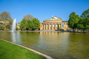 Stuttgart State Theatre Opera building and fountain in Eckensee lake, Germany