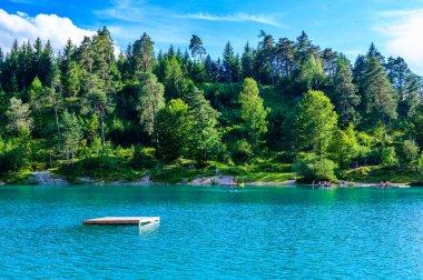 Urisee - clear blue water of Laki Uri at Reutte in Tirol, Austria stock vector