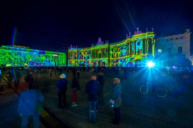 BERLIN - OCTOBER 07, 2018: The Bebelplatz, Hotel de Rome (left) and Humboldt University law faculty (right) in brightly colored illuminations. Lens flare. Festival of lights 2018.