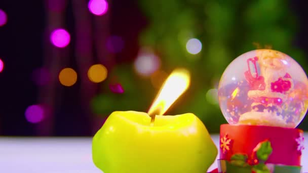 Footage of burning candle and globe snow Christmas collection