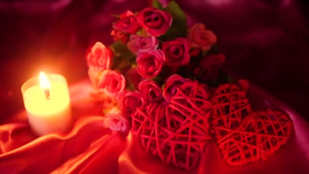 Footage of flower bouqet, candle burning, and decoration Valentine collection
