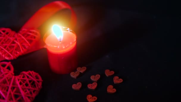 Footage decoration Valentine of red ribbon, candle burning and wooden love collection