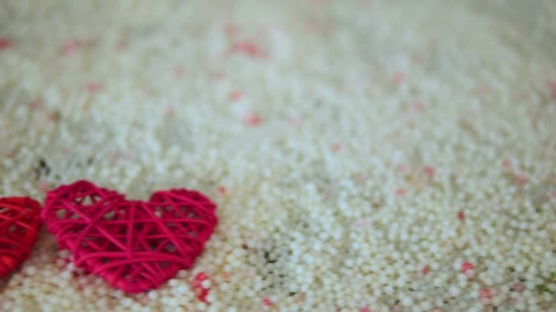 Footage of heart decoration on sand for Valentine day collection
