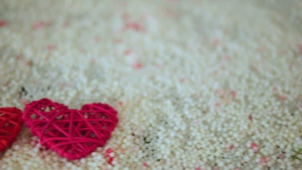 Záběry ze srdce dekorace na písku pro Valentine den kolekce