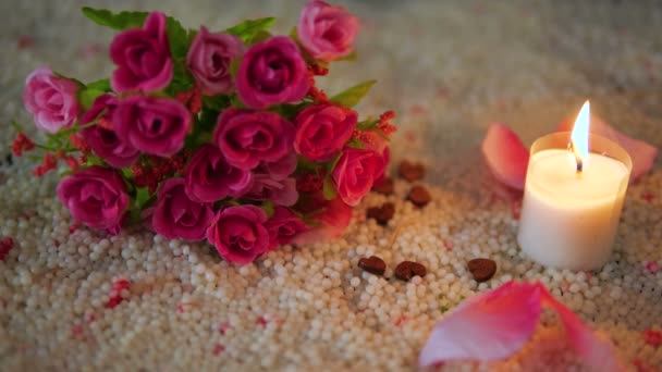 Decoration footage valentine of flower bouquet, candle burning and rose petals collection