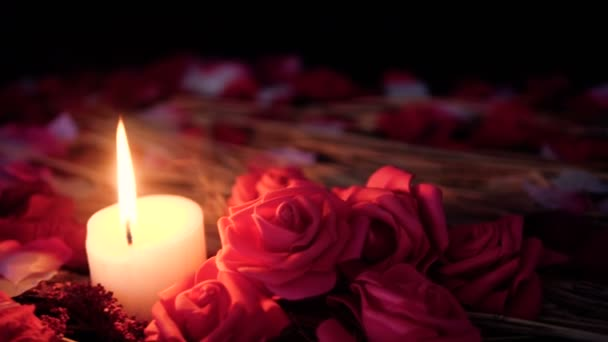 Footage move of rose petals, candle burning and flower rose. Valentine day collection