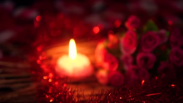 Footage blur of flower petals, rose bouquet and candle burning. Valentine day collection