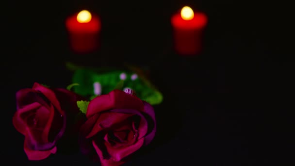 Footage of Valentine day with candle burning and red flower rose collection