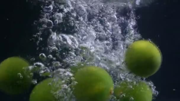 Lime fruit splash falling down water. Footage collection