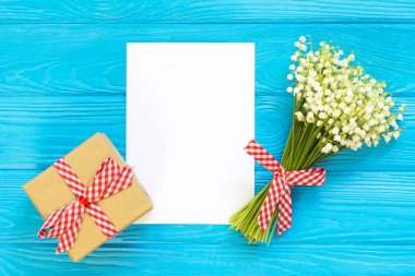 Mothers day. Womens day. Valentines day, Birthday greeting background. Lily of the Valley, envelope, packing gifts.