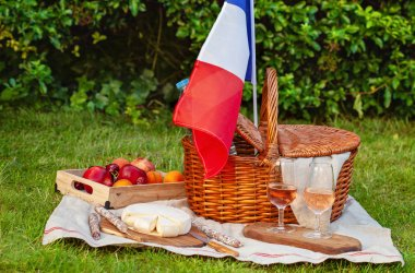 Festive picnic for national holiday of France 14th of July with French flag