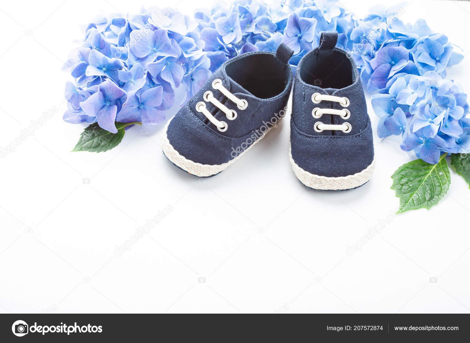 fe29e480e96b Cute Newborn Baby Boy Shoes Festive Decoration White Background Baby —  Stock Photo