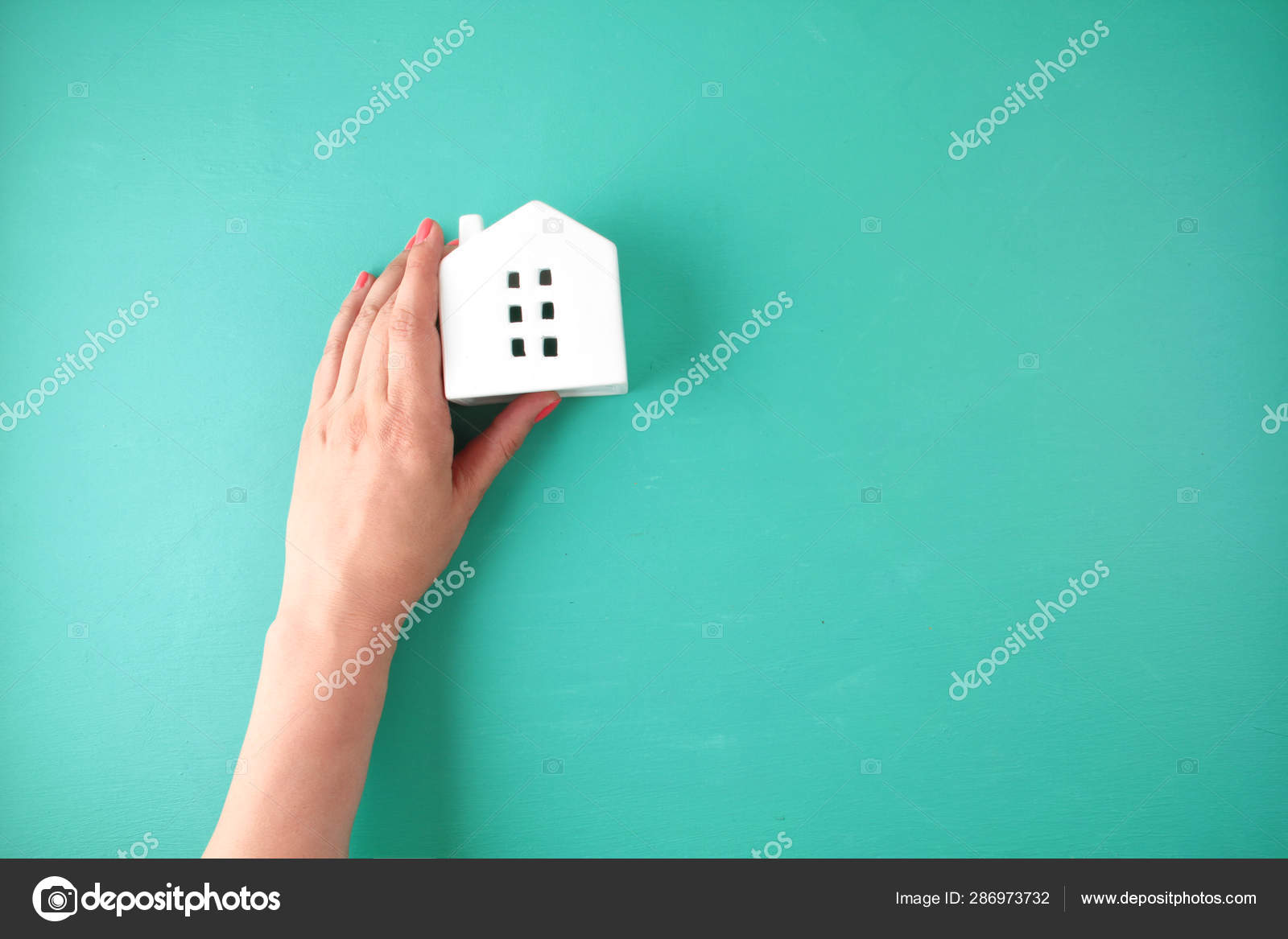 Woman Hand Holding Small Toy House Stock Photo C Netrun78 286973732